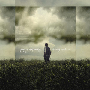 Evening Machines album cover; broody clouds, field, Gregory Alan Isakov
